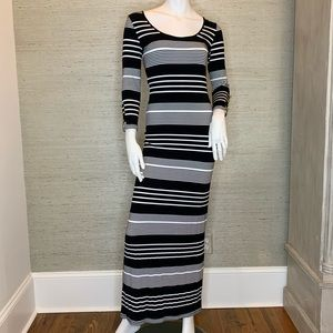 Black/white striped maxi dress. Long sleeved